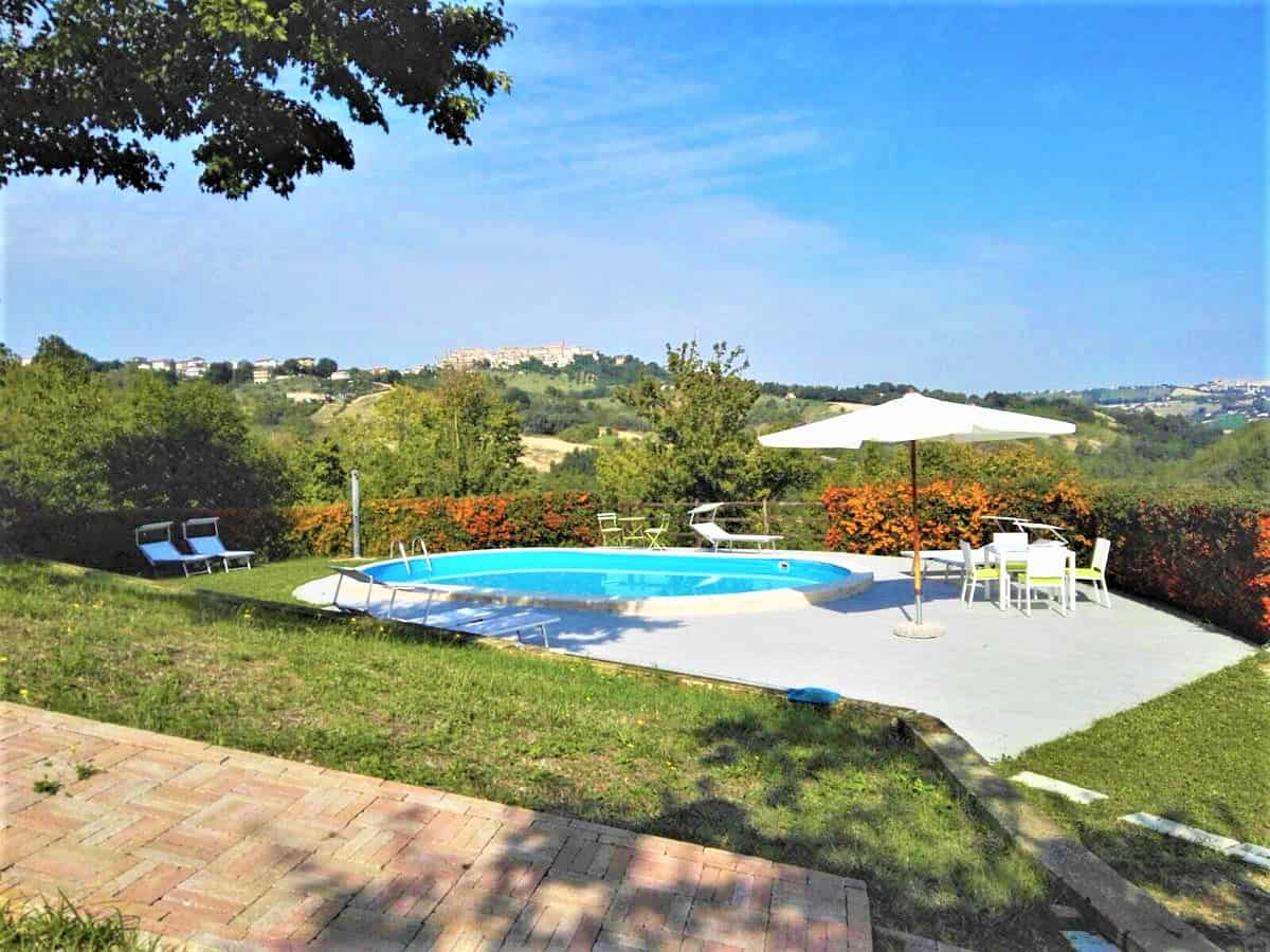 Restored house with pool and land in Montappone